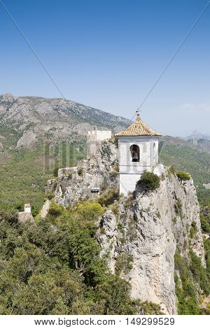 Belfry on the peak of the mountain. This tower belongs to Alcozaiba fortress built by muslims at XI century. Picture taken in El Castell de Guadalest Alicante Spain.