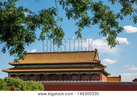 Traditional Chinese architectural roof, with animals. Immortal and beasts on the roof slope. Authentic China city, The yellow roof tiles with dragon