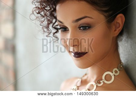 Fashion. Beautiful woman with bizarre hairdo