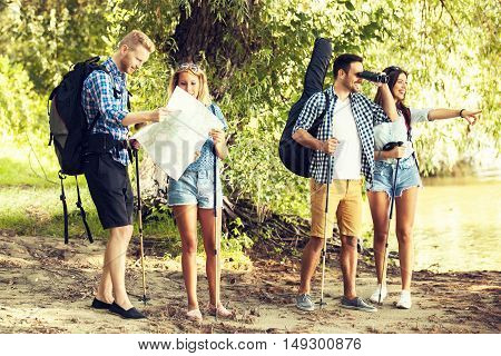 Group of friends in nature. They are looking for best location to camp.