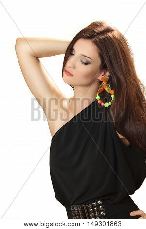 beautiful young woman in a black dress with bright big earrings. isolated on a white background