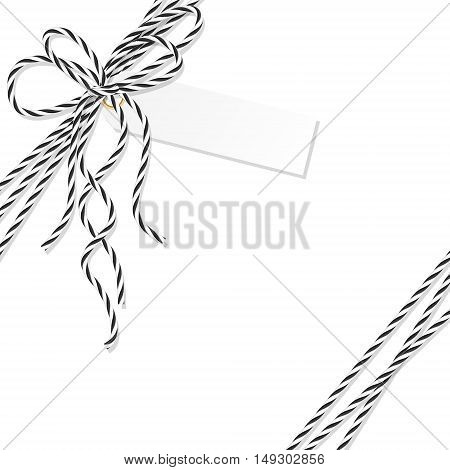 Abstract white background with tag label tied up with black rope bakers twine bow and ribbons