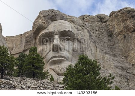 The face of Abraham Lincoln on Mount Rushmore.
