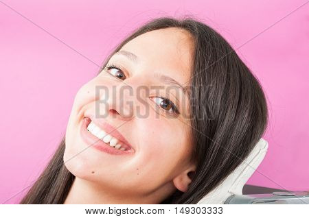 Girl Sitting In Dentist Chair And Showing Big Smile