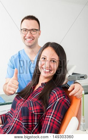 Dentist With Patient In Chair Showing Thumb Up