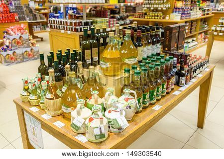 EDINBURGH, SCOTLAND - CIRCA NOVEMBER 2012: Choice of olive oil bottles at Jenners department store.