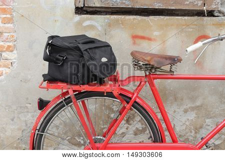 Bag Black bicycle travel saddle Closeup old brick wall background