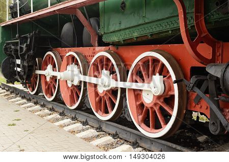 Traction Wheel Of Old Steam Locomotive On The Rails