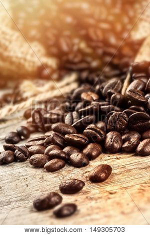 Roasted coffee beans on wooden table. Closeup