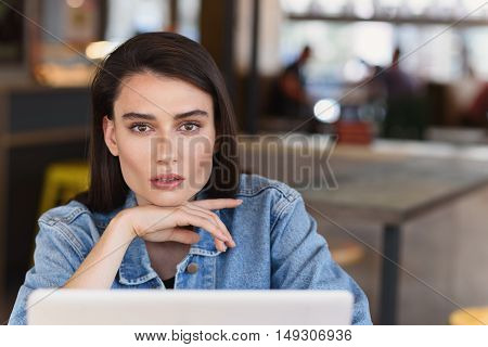 close up of a beautiful young woman in a public place