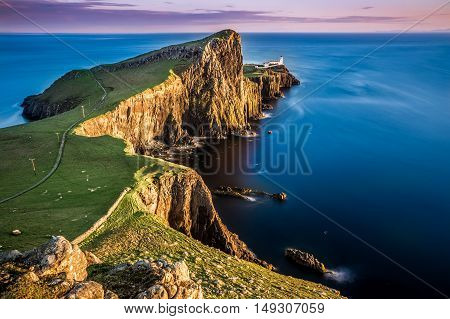 View of Neist Point lighthouse and rocky ocean coastline on the Isle of Skye, Scotland