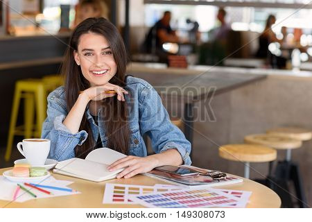 fashion blogger resting in a restaurant with her accessories