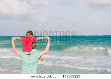 happy father and son playing on sea vacation