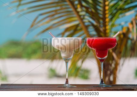 Two cocktails on luxury tropical sand beach, vacation concept