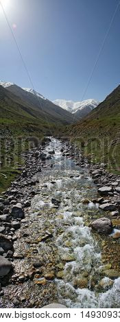 Vertical panorama of the river in the mountains of Kyrgyzstan in summer