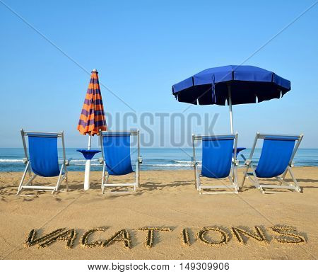 Sun loungers and umbrellas on a sandy beach. Vacation concept.