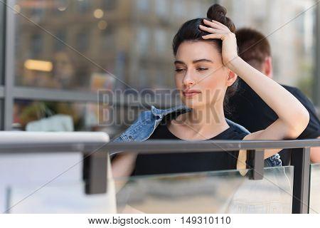 happy female designer sitting in front of laptop