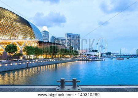 Singapore central quay evening panorama with wooden pier on foreground