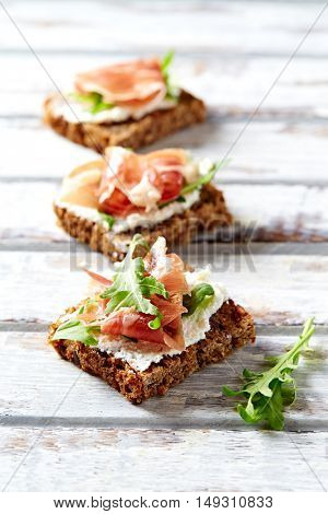 Wholegrain canapes with cream cheese and ham