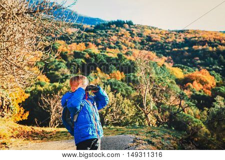 little explorer hiking in autumn mountains, family travel