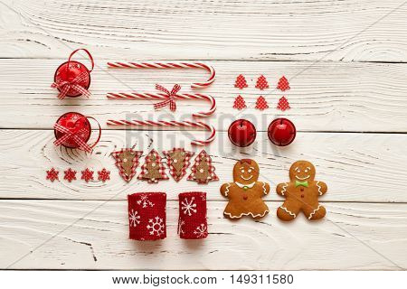 Christmas homemade gingerbread cookies and handmade decoration on wooden background flat lay still life
