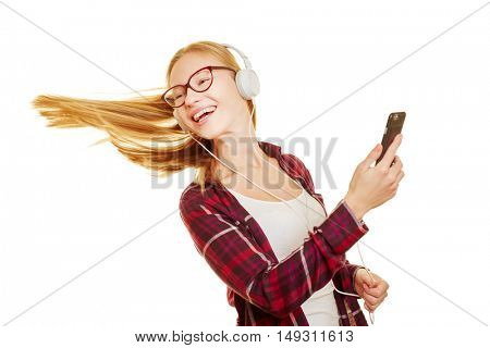 Young bold girl dancing to the music comming from her smartphone with headphones