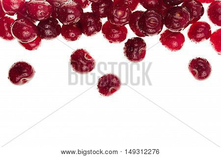 Scattered cherry on a white background. Decorative frame of fruits. Isolated. Macro. Food background. Copy space.
