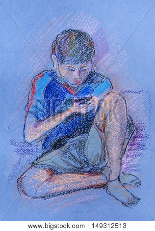 The portrait of boy playing  the game-boy