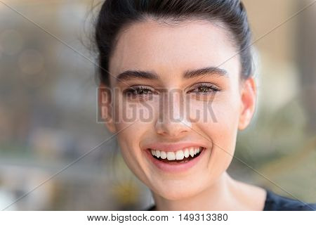 happy face of a girl smiling into camera with copy space