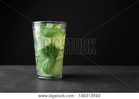 Delicious mojito with mint and lime slices on gray table
