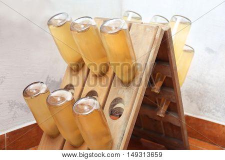 Bottles with wine on shelf in cellar