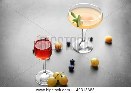 Delicious cocktail on gray table