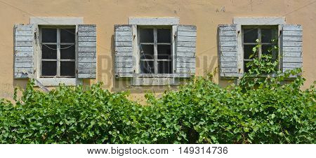 Shuttered windows in an old building in the historic Montenegrin town of Budva.
