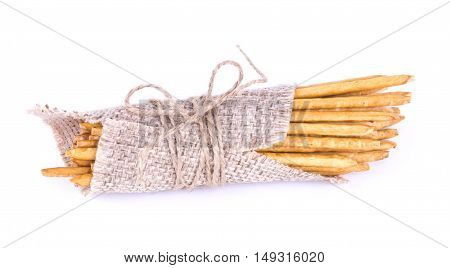 Salted Sticks Tied. Straws In Sackcloth Isolated. Salty Sticks Wrapped.