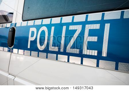German police sign on the patrol car