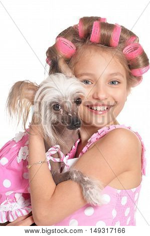 portrait of happy Little pretty girl   in hair curlers with dog in studio