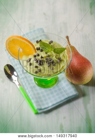 mousse with avocado pear and chocolate drops, selective focus