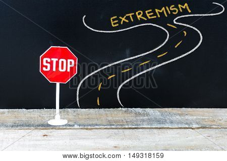 Mini Stop Sign On The Road To Extremism