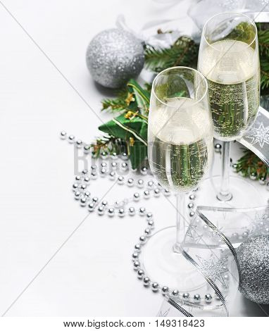 Two champagne glasses and silver christmas ornaments