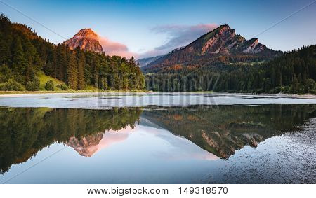 Great view of the azure pond Obersee glowing by sunlight. Popular tourist attraction. Picturesque and gorgeous scene. Location famous place Nafels, Mt. Brunnelistock, Swiss alps, Europe. Beauty world.