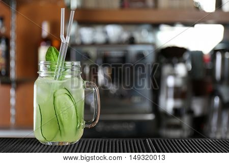 Cocktail in glass jar on bar counter