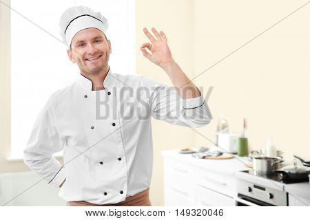 Young chef cook in kitchen