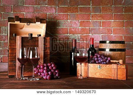 Composition of red wine on brick wall background
