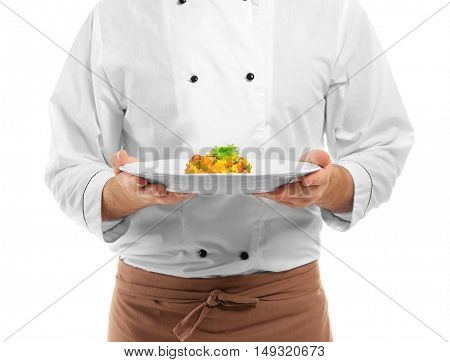 Young chef cook with dish on plate isolated on white
