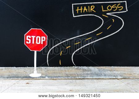 Mini Stop Sign On The Road To Hair Loss