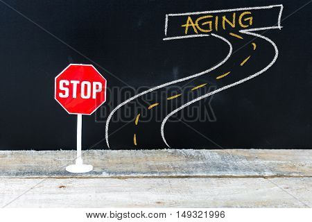 Mini Stop Sign On The Road To Aging