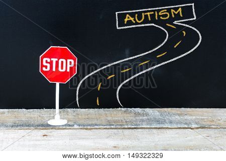 Mini Stop Sign On The Road To Autism