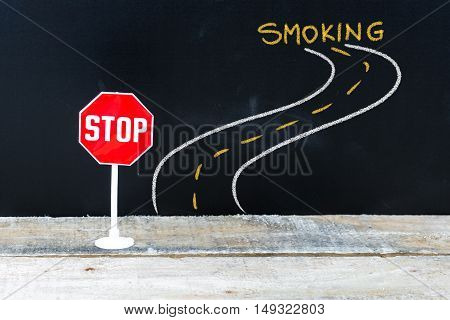 Mini Stop Sign On The Road To Smoking