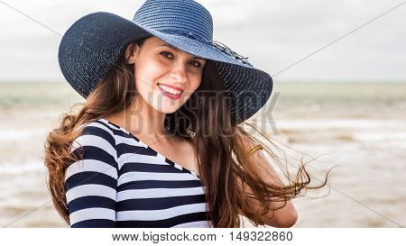 Beautiful young pregnant woman on the beach feels peace and tranquility