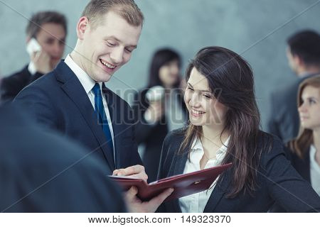 Couple standing on the street and viewing the newspaper